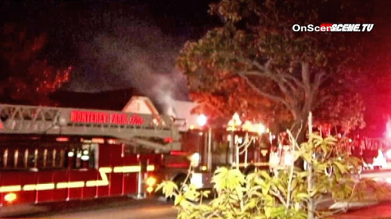 Firefighters are seen at an apartment fire in Alhambra on Sunday, Nov. 4, 2012. Four people were injured in the blaze.