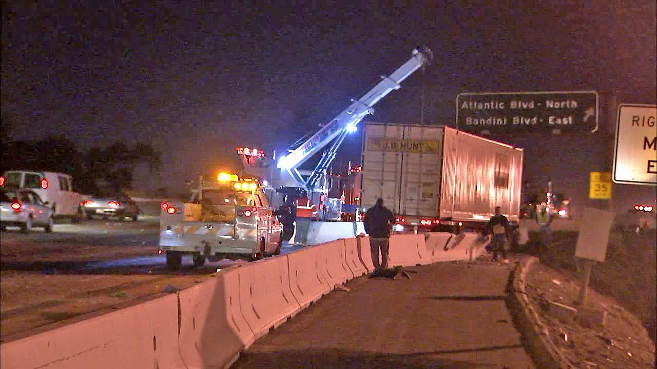 A big-rig is seen after it crashed into a wall while trying to miss a stalled truck on the northbound 710 Freeway in Vernon on Tuesday, Nov. 13, 2012.