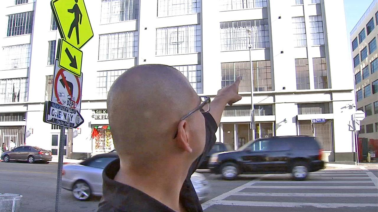 Jeff Cote points to a loft he owns in the Little Tokyo area of downtown Los Angeles in this photo from fall of 2012. He says a squatter has lived in his empty loft for the last three years and refuses to leave.