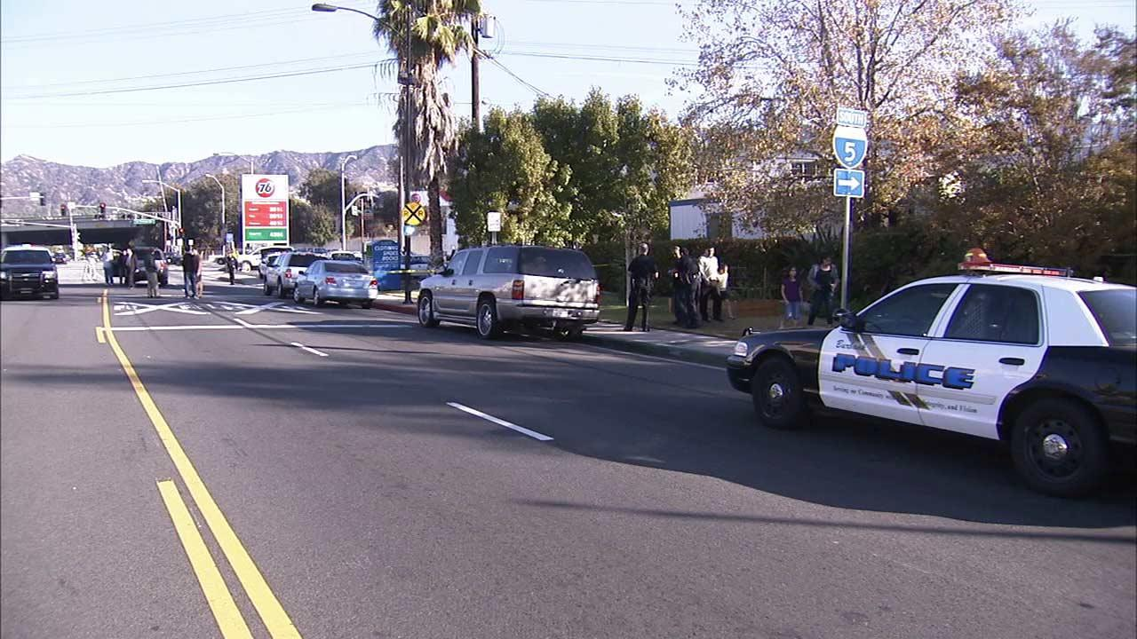 Police say a man and woman were engaged in a child custody exchange at Buena Vista Street and San Fernando Road on Wednesday, Nov. 21, 2012, when he stabbed her.