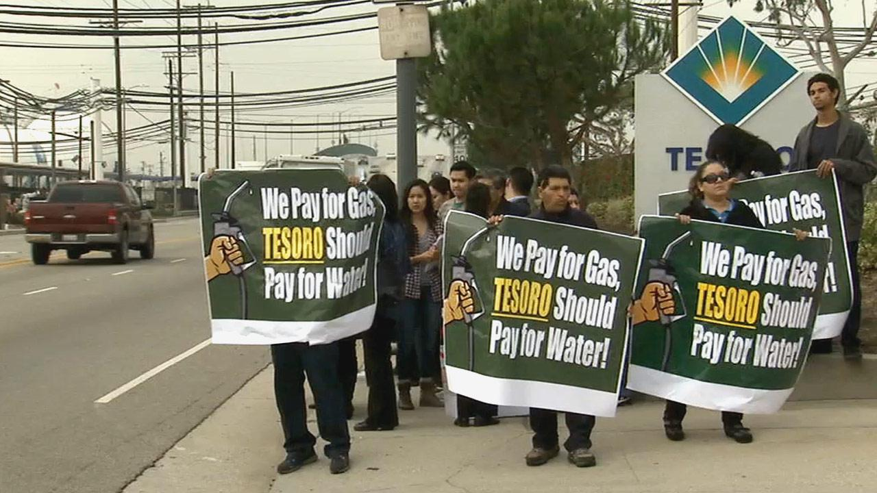 A group of protesters gathered outside the Tesoro refinery in Wilmington on Wednesday, Nov. 28, 2012, claiming the company wont pay its water bill and that its a direct threat to the water supply of dozens of communities.