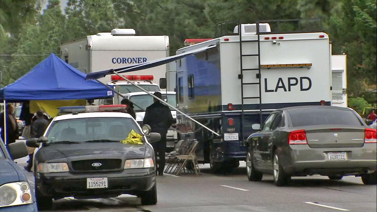 Police investigate a shooting in Northridge, where four people were found dead on Sunday, Dec. 2, 2012.