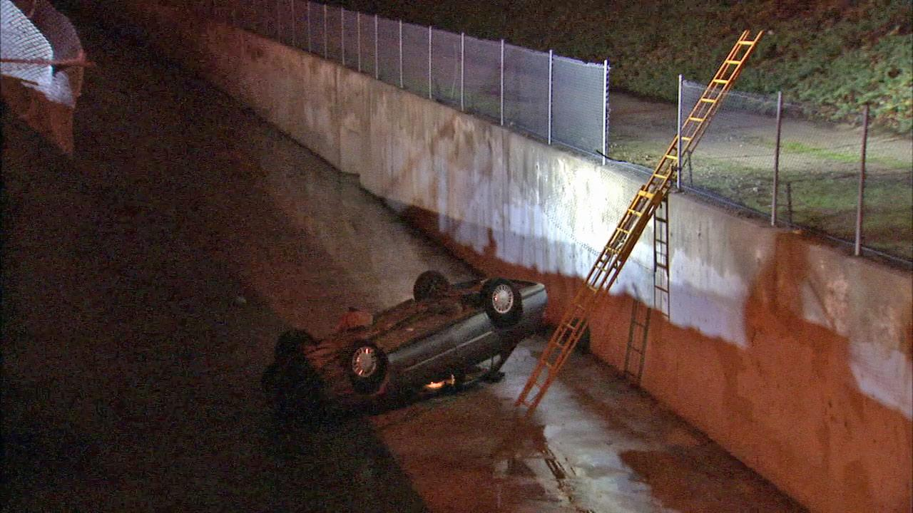 Rescuers pulled two people from a car that plunged into the wash in Sun Valley on Sunday, Dec. 2, 2012.