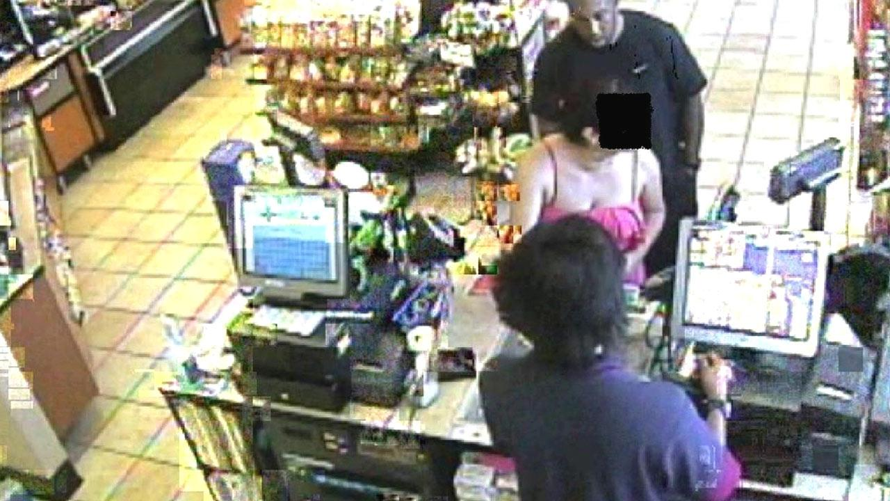 A surveillance camera image shows a suspect taking a photo of a woman at a Chevron station on North Sepulveda Boulevard in Manhattan Beach on Aug. 19, 2012.