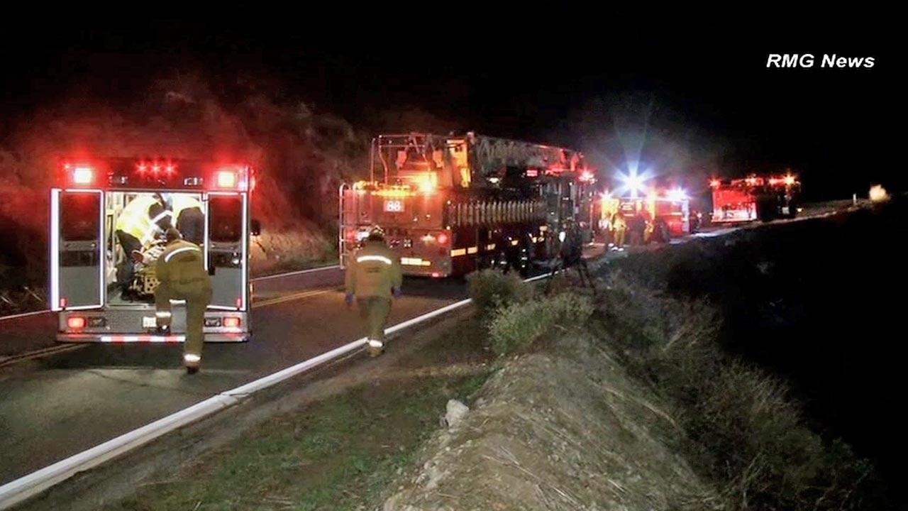 Fire officials say a car carrying four people and speeding plunged off the side of a Glendora Mountain Road Thursday, Dec. 6, 2012.