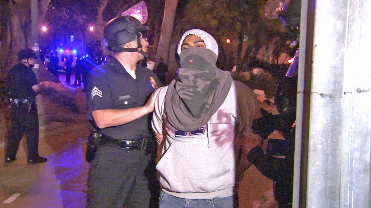 A protester is detained during an Occupy Los Angeles demonstration in this file photo.