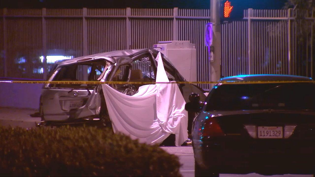 At least two people died in a crash with an SUV being pursued by police in Pasadena on Tuesday, Dec. 25, 2012.