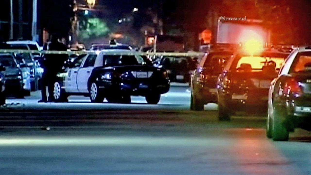 Los Angeles police cars are seen near the scene where officers shot a suspect who allegedly pointed a gun at a security guard on the 8300 block of Cedros Avenue on Saturday, Dec. 29, 2012.