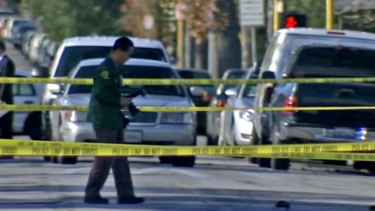 Crime scene tape ropes off the scene of a stabbing death in San Fernando on Sunday, Dec. 30, 2012.