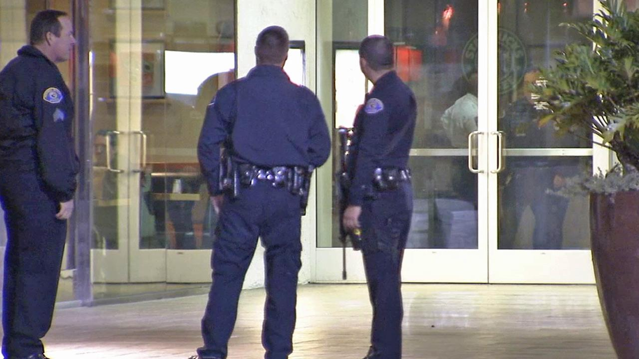 Law enforcement officials are shown at the South Bay Galleria after two minors were stabbed by an unknown assailant on Saturday, Dec. 29, 2012.