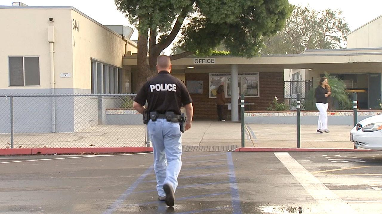 A police officer arrives at a Los Angeles school in this undated file photo.