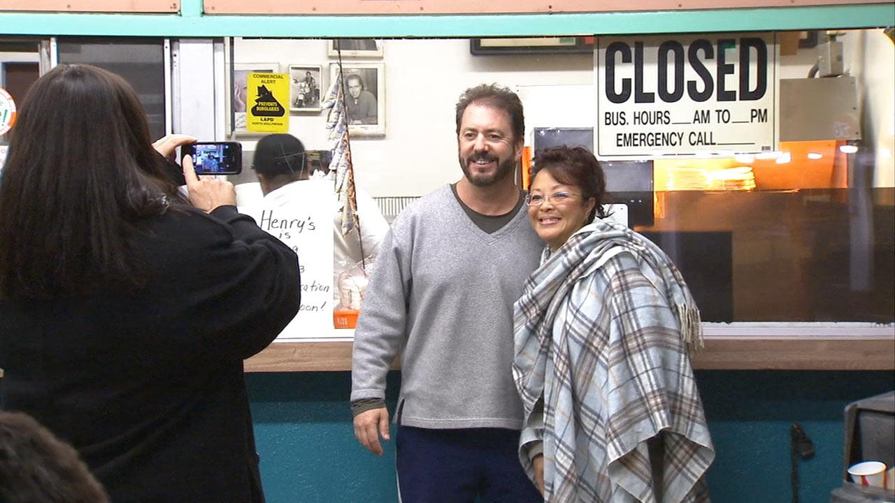 Fans of Henrys Tacos take a photo in front of the Studio City eatery on Saturday, Jan. 12, 2013, the night it closed after 51 years in business.