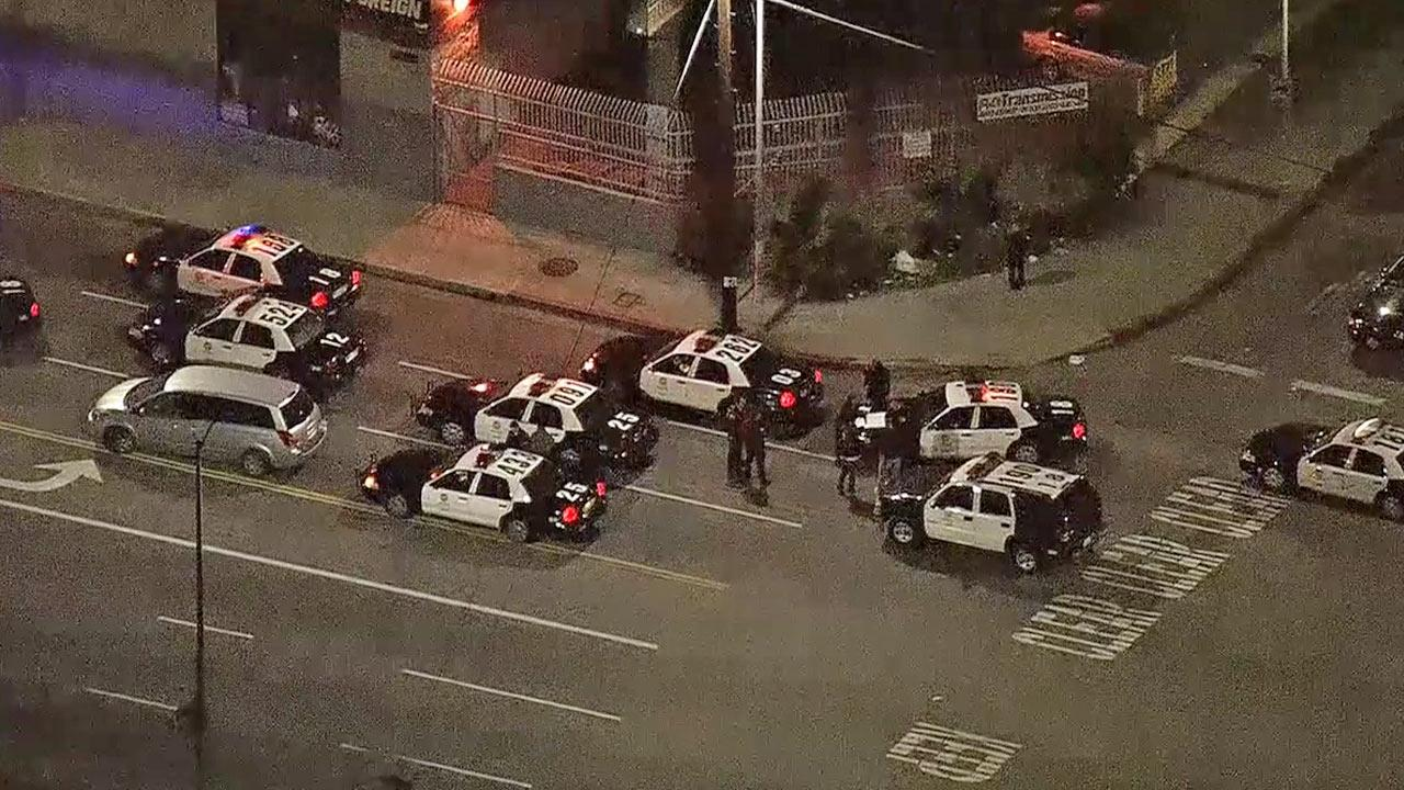 LAPD patrol cars are shown at the scene where shots were fired near Vermont and Rosecrans avenues in South Los Angeles on Tuesday, Jan. 16, 2013.