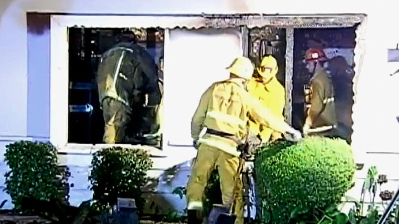 Firefighters are shown at the scene of a house fire in the 9100 block of Monogram Avenue in North Hills on Saturday, Jan. 26, 2013.
