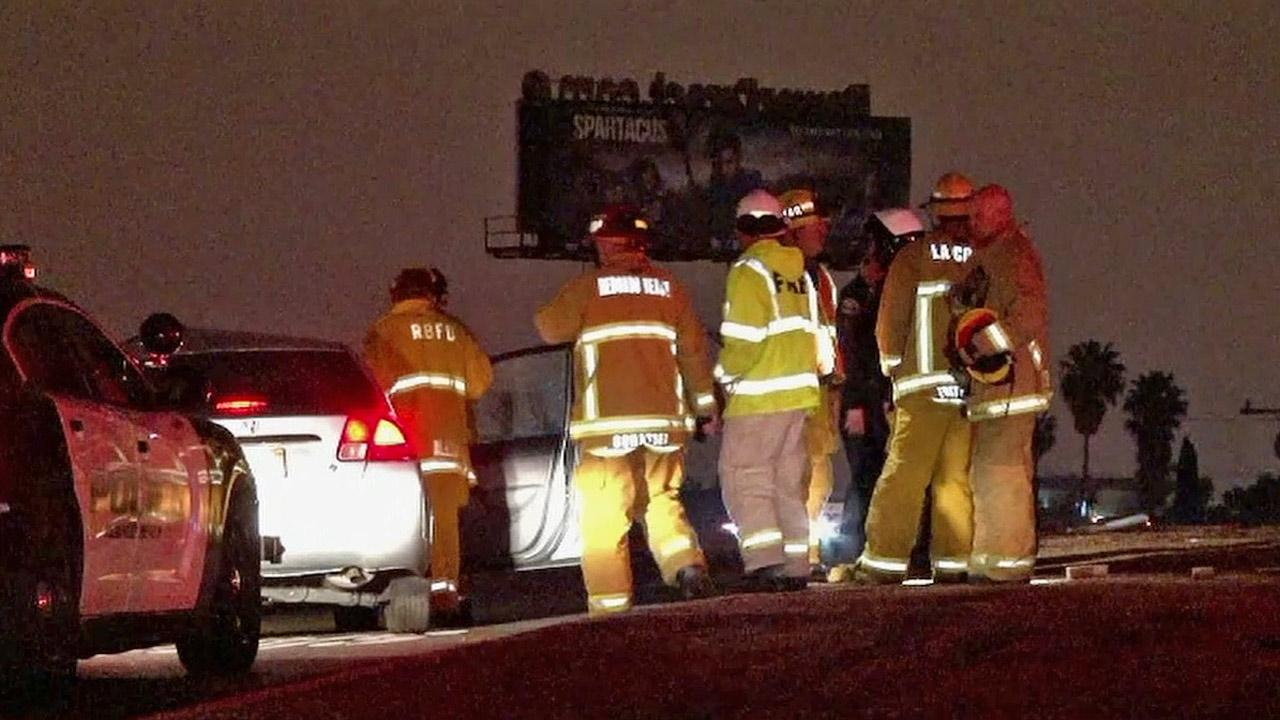 Emergency personnel are shown at the scene of a fatal car crash on the 405 Freeway Inglewood Boulevard off ramp.