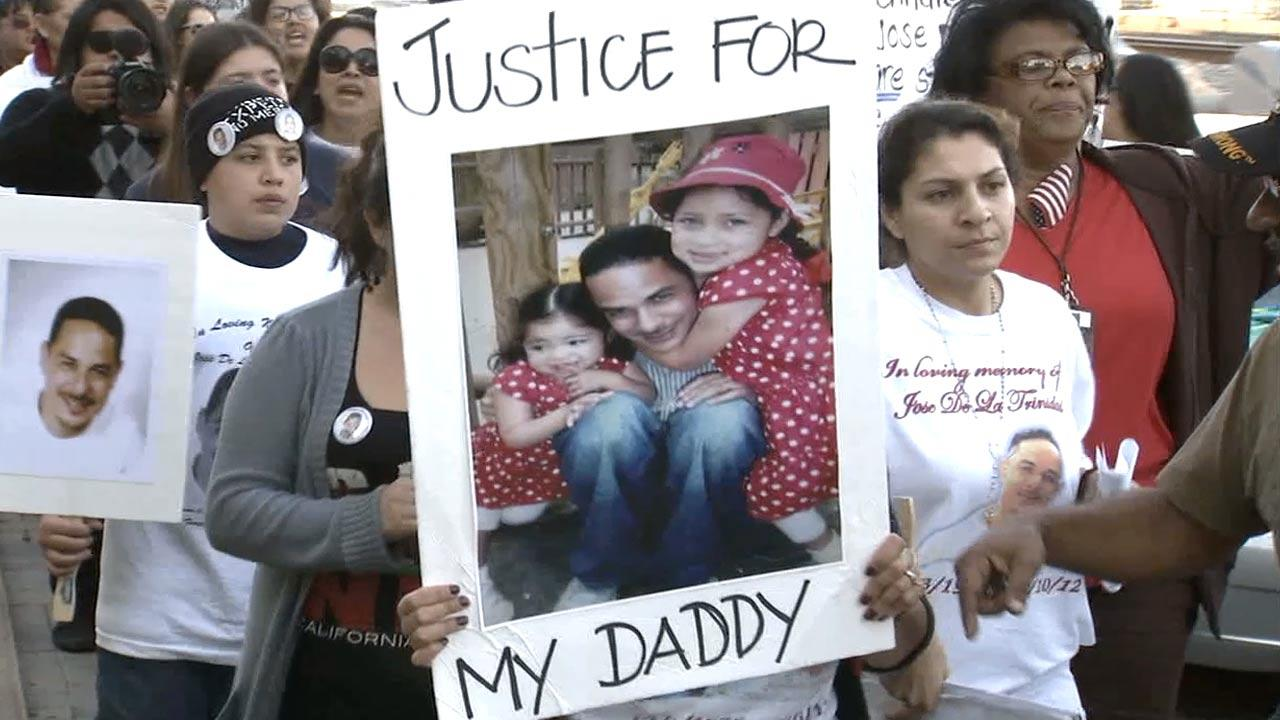 Friends, family and community members hold a march for 36-year-old Jose De La Trinidad, who was shot by Los Angeles County sheriffs deputies on Nov. 10, 2012.