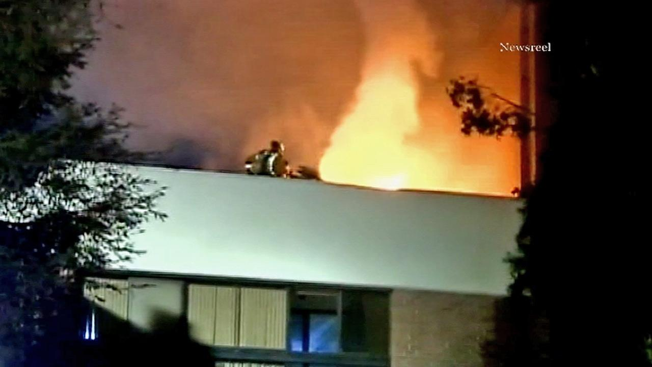 Firefighters battle a fire that broke out at a condominium complex in the 4400 block of Wilshire Boulevard in Hancock Park on Wednesday, Jan. 30, 2013.