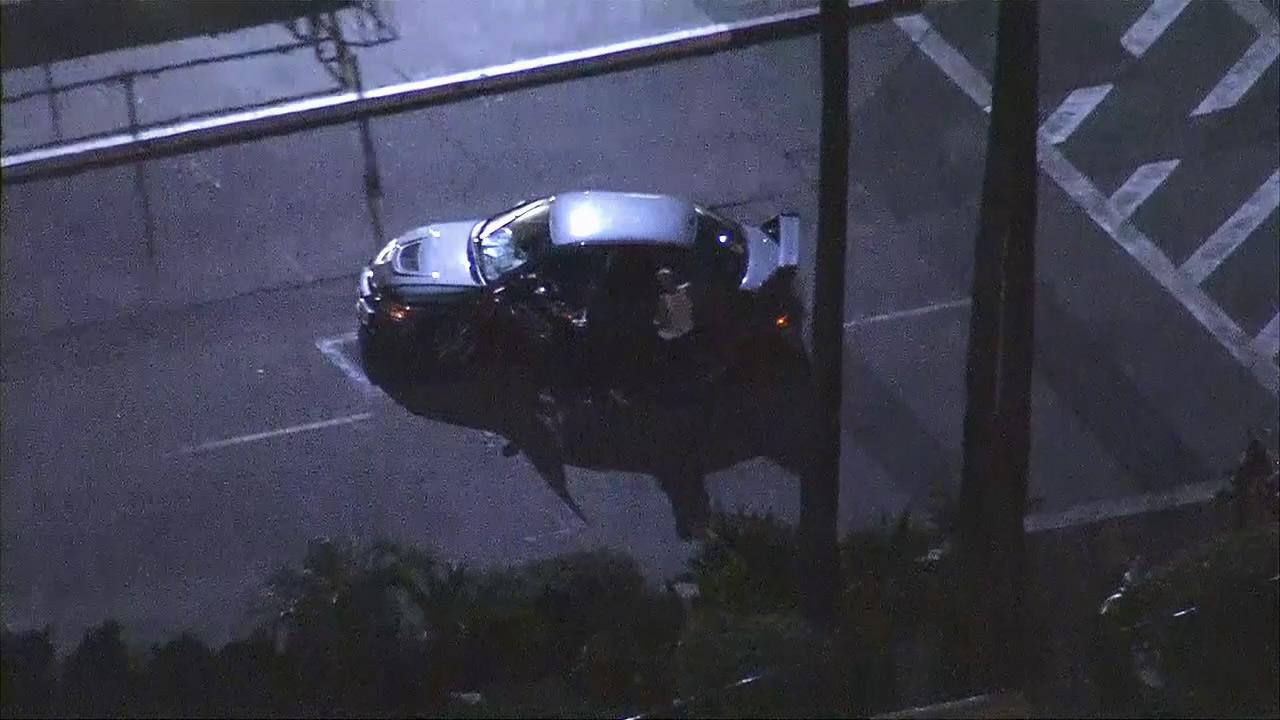 A suspect led authorities on a low-speed pursuit that ended in front of the Long Beach Airport on Wednesday, Jan. 30, 2013.