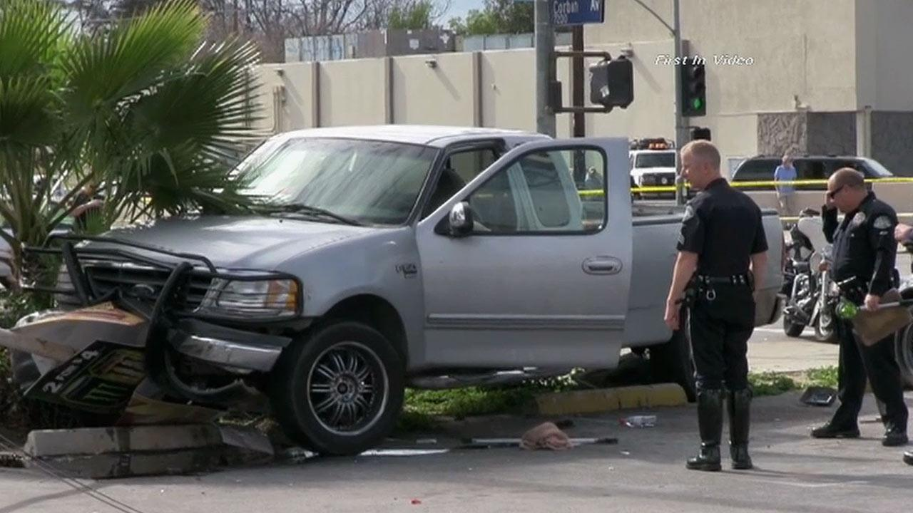Officers are seen investigating the scene of a crash after an alleged car thief slammed head-on into a pole on Sherman Way in Winnetka while evading police on Saturday, Feb. 2, 2013.