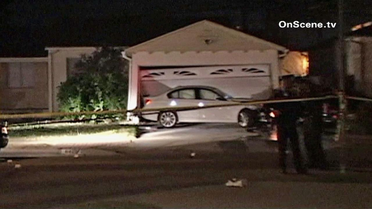 Crime tape ropes off a scene in Long Beach, where an armed robbery suspect crashed a stolen car in the 6400 block of Keynote Street on Thursday, Feb. 21, 2013. Long Beach police say the suspect fired at them, and they returned fire, killing him.