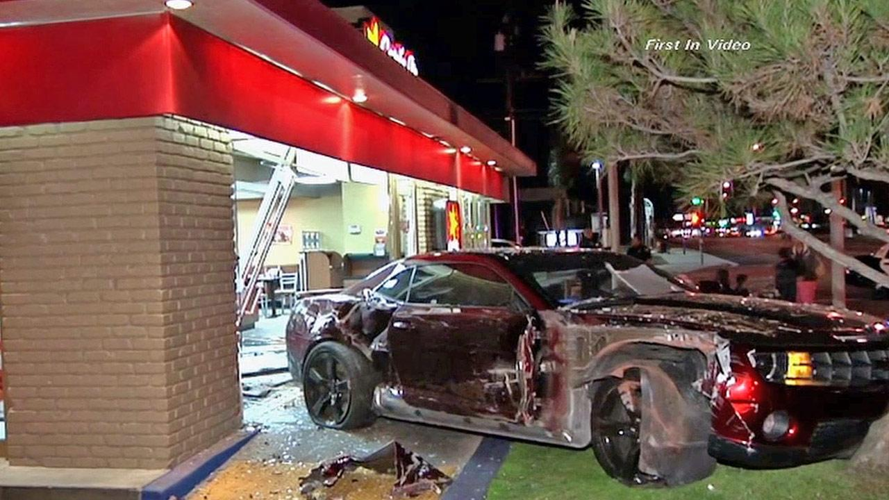 A Chevy Camaro jumped a curb and crashed into a Carls Jr. restaurant in Santa Fe Springs on Wednesday, Feb. 27, 2013.