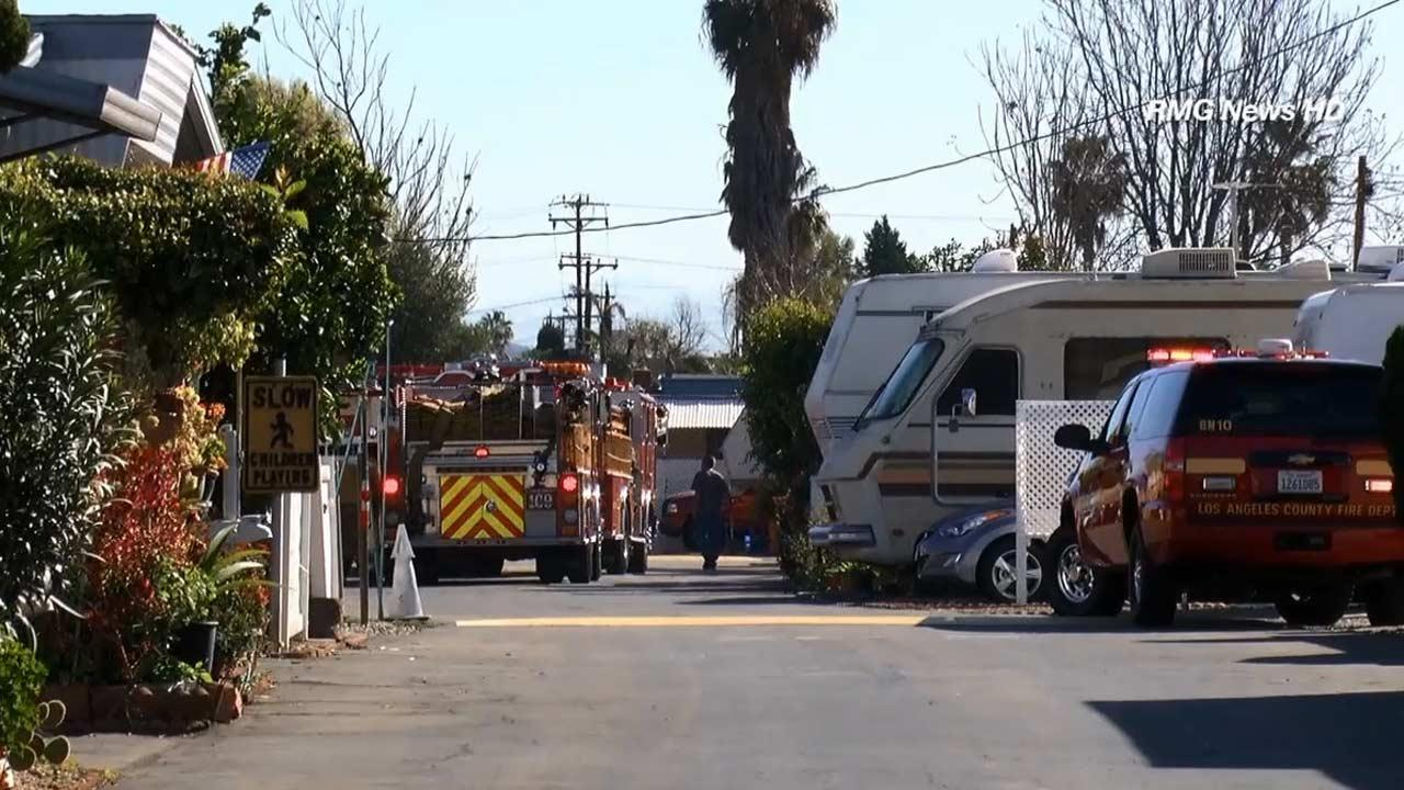 Firefighters are seen investigating a blaze at a mobile home on the 2500 block of South Peck Road in an unincorporated area near Monrovia on Saturday, March 2, 2013.