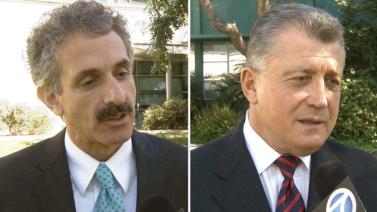 Candidates for Los Angeles city attorney, Mike Feuer (left) and Carmen Trutanich.