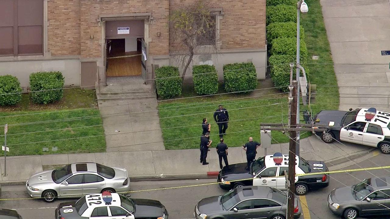 LAPD officers investigate a shooting in front of 92nd Street Elementary School in Watts on Tuesday, March 5, 2013.