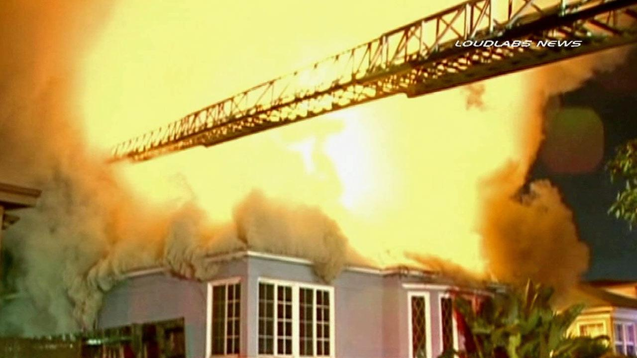 A Mid-City house is shown engulfed in flames on Friday, March 8, 2013.