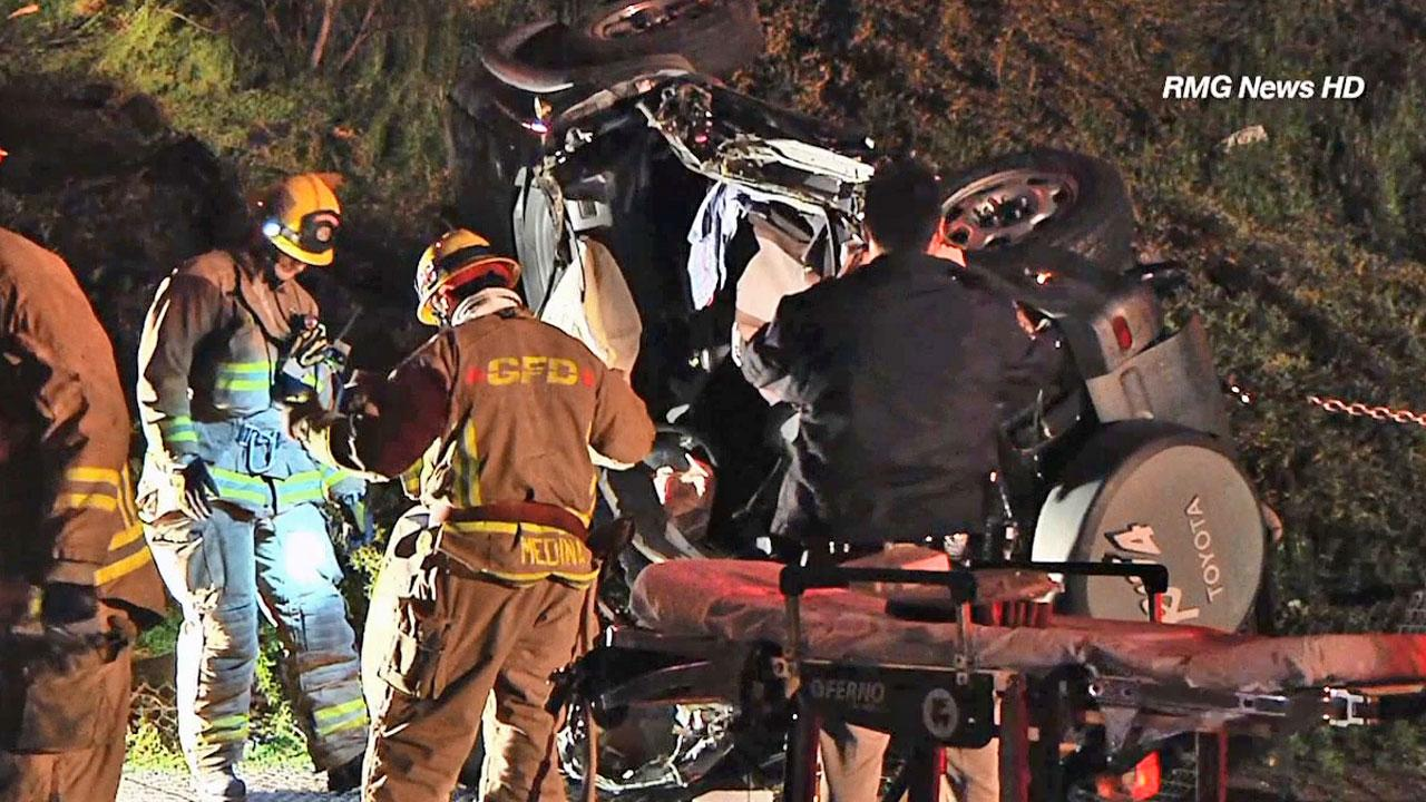 Emergency crew members are shown near the scene of a car crash off the 134 Freeway in Glendale on Saturday, March 9, 2013.