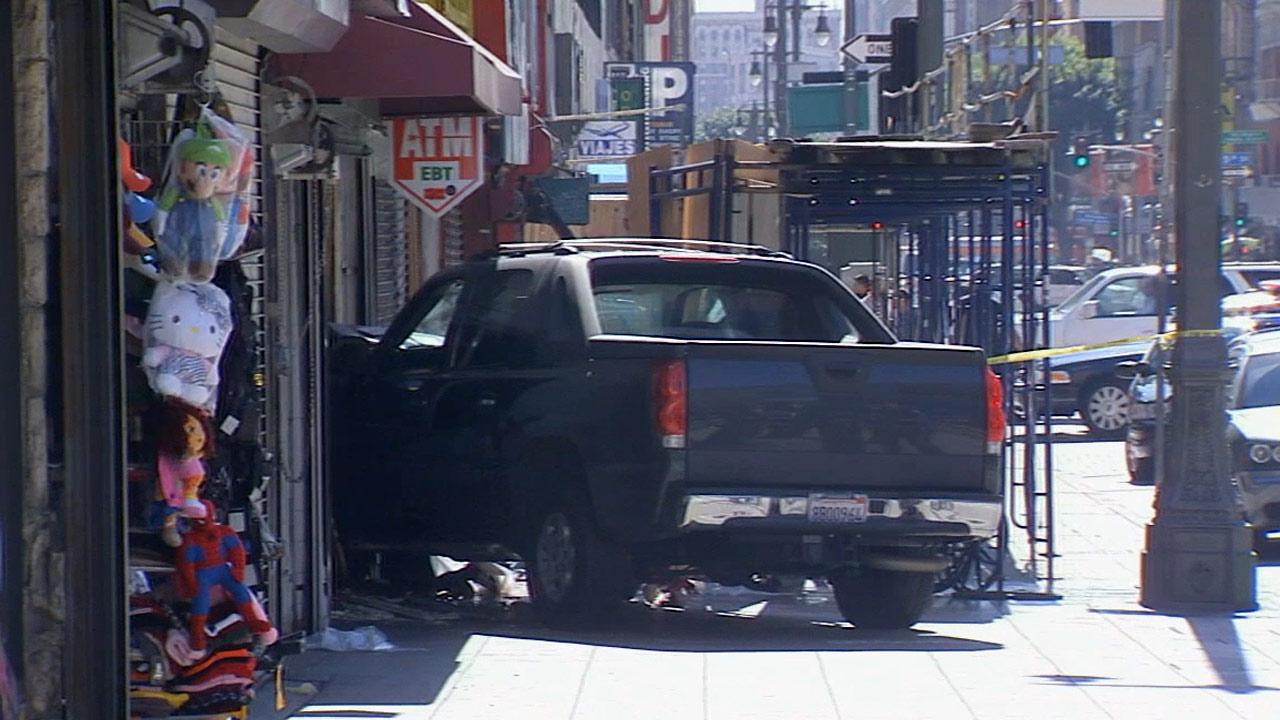 A pedestrian was killed and six other people were injured when a pickup truck veered onto a busy downtown Los Angeles sidewalk on Sunday, March 10, 2013.