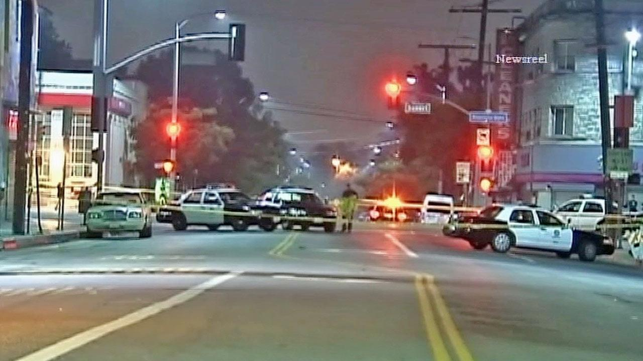An investigation is under way after a man was wounded by police following a confrontation near Sunset Boulevard and Echo Park Avenue in the Echo Park section of Los Angeles on Tuesday, March 19, 2013.