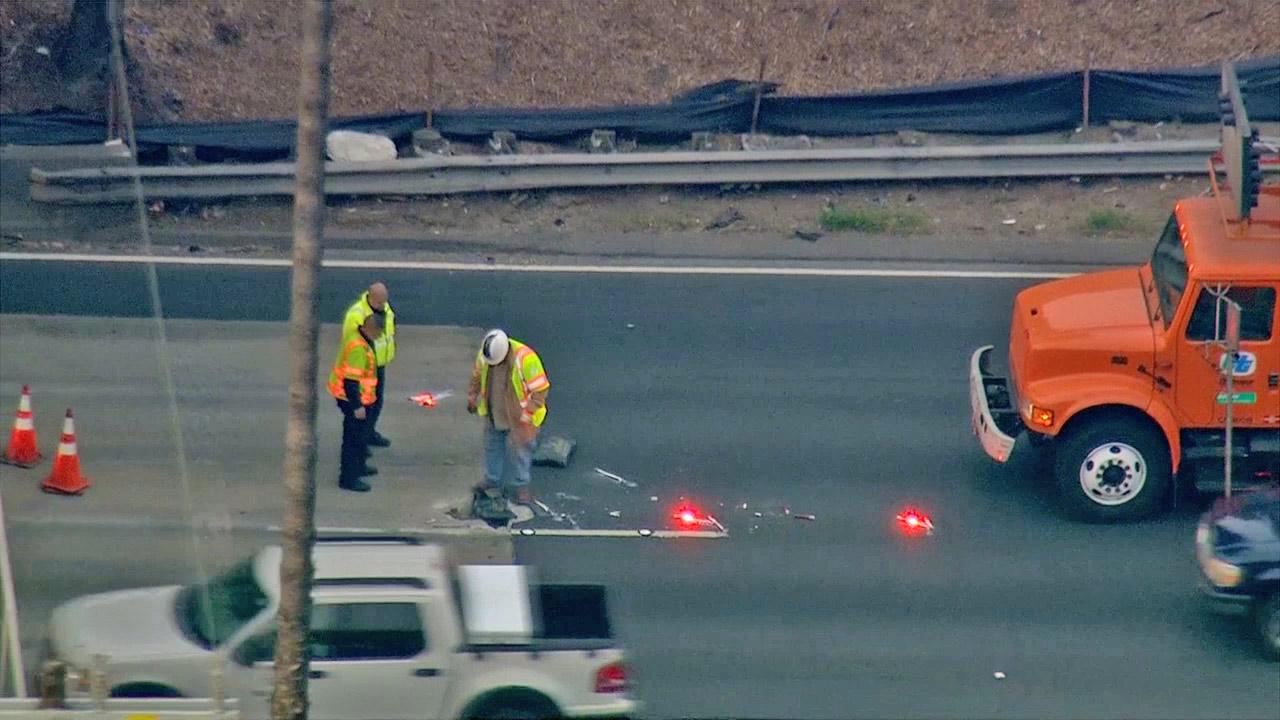 Crews work to repair a huge pothole on the Golden State (5) Freeway Wednesday, March 20, 2013.