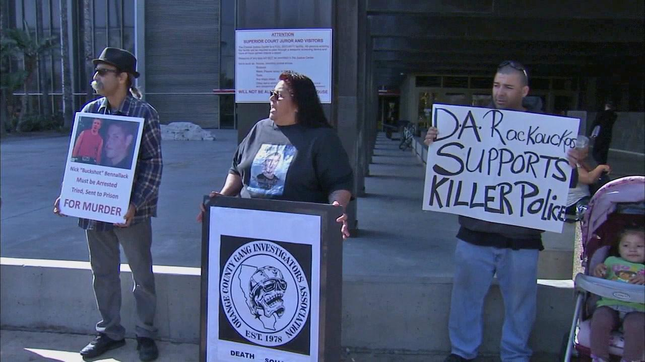 Genevieve Huizar, mother of Manuel Diaz, who was shot and killed by police on July 21, 2012, holds a protest in front of the central courthouse in Santa Ana Thursday, March 21, 2013.