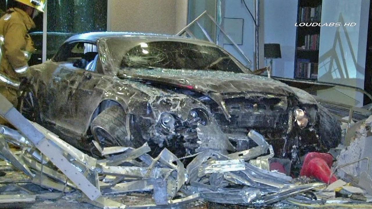 A Bentley belonging to Los Angeles Laker forward Jordan Hill crashed into a Marina del Rey building on Saturday, March 30, 2013.