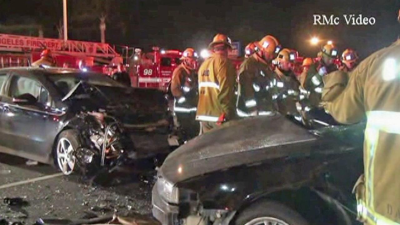 Firefighters gather at the scene of a fatal car crash near Rinaldi Street and Laurel Canyon Boulevard in Mission Hills on Sunday, March 31, 2013.