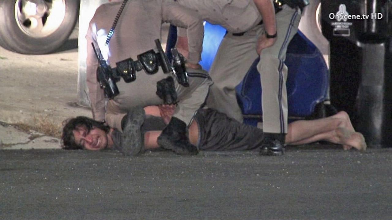 A police pursuit and foot chase ended with a suspect slammed to the pavement in San Pedro early Wednesday, April 4, 2013.