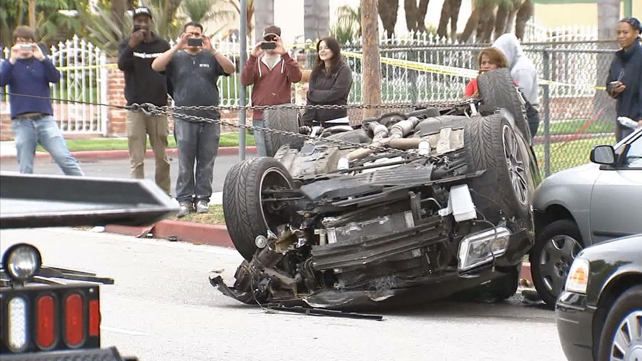 Los Angeles police were investigating an apparent street racing crash in the Mid-City area on Saturday, April 13, 2013.