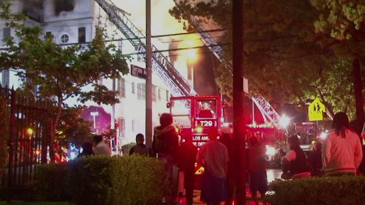 A fire broke out at a vacant apartment building on the corner of Serrano Avenue and San Marino Street in Koreatown on Monday, April 15, 2013.