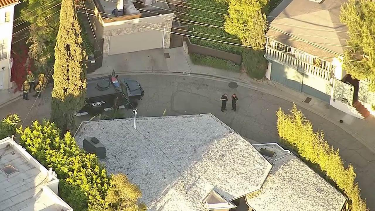 Law enforcement officials are shown in the 2500 block of Hargrave Drive in Hollywood, the scene of a SWAT standoff on Wednesday, April 17, 2013.