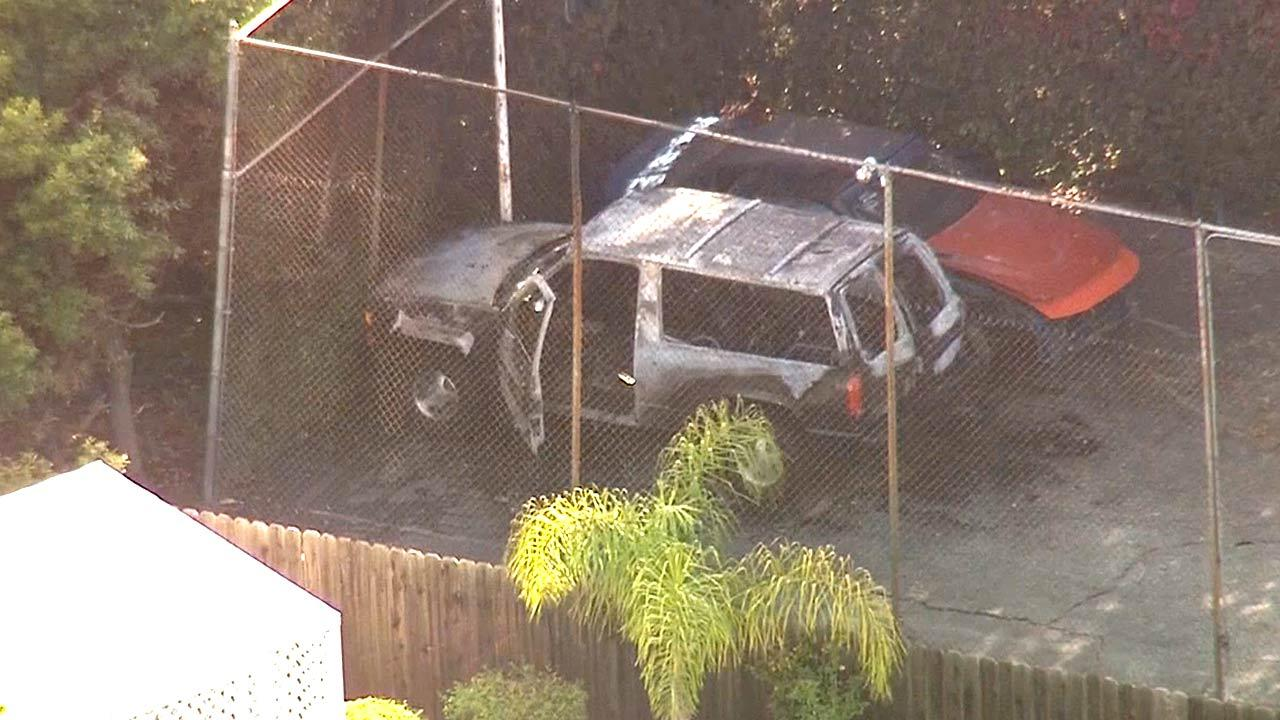 Homicide detectives were working to determine whose charred remains were discovered in a burned-out SUV in Rancho Palos Verdes on Tuesday, April 23, 2013.