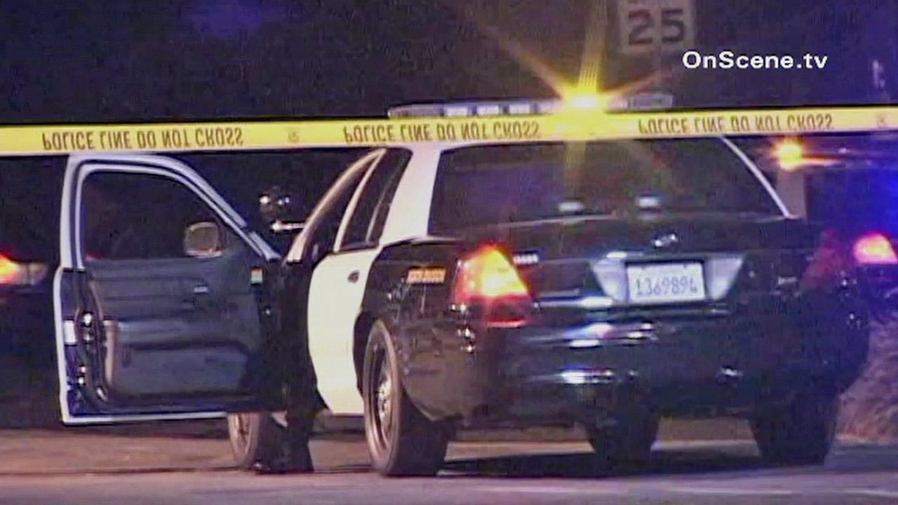 Crime tape is shown behind a law enforcement vehicle at the scene of an officer-involved shooting in Long Beach on Sunday, April 28, 2013.
