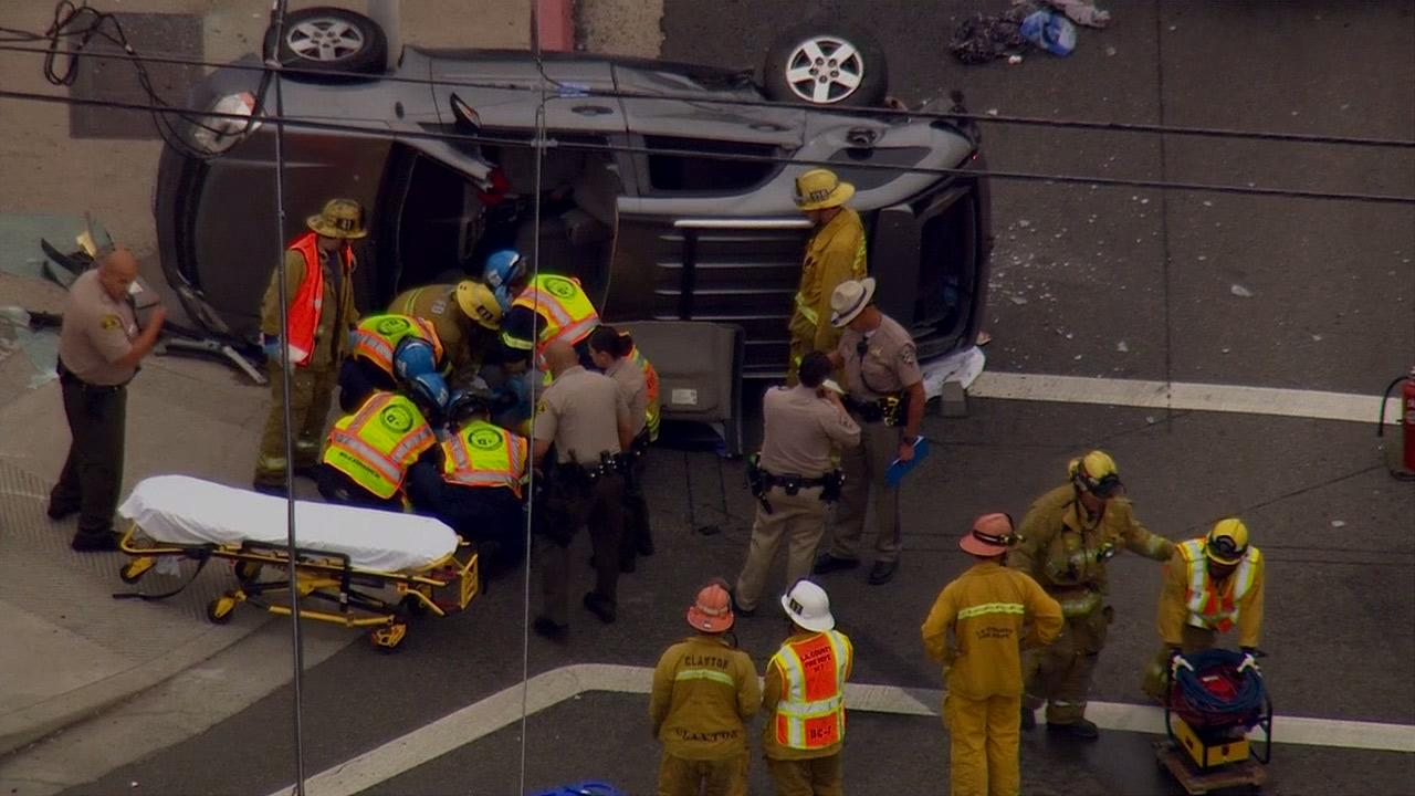 An innocent driver was trapped inside a vehicle after being hit by a pursuit suspect at Avalon Boulevard and 135th Street in Rosewood on Wednesday, May 1, 2013.