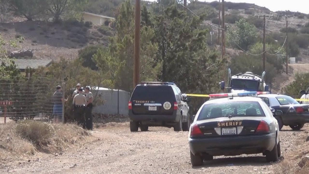 Los Angeles County Sheriffs Department patrol cars are shown near the scene of a fatal shooting in Acton.