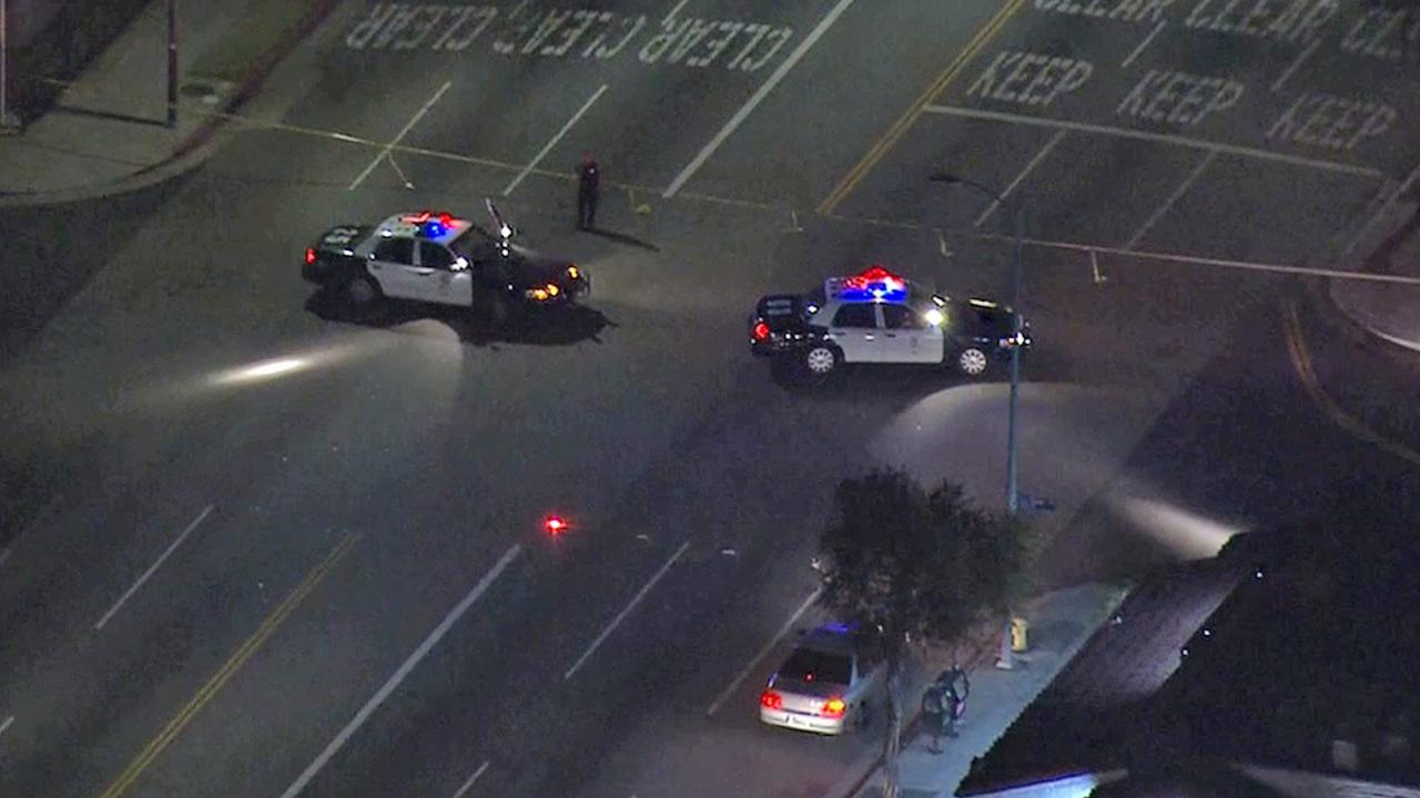 Law enforcement vehicles are shown in a South Los Angeles intersection, investigating a possible gang-related shooting on Friday, May 17, 2013.