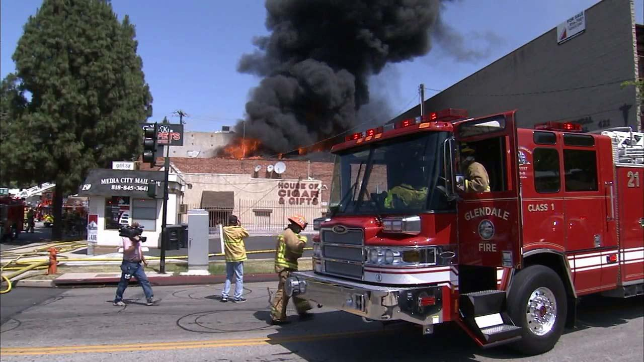 A three-alarm fire erupted at a carpet store near Angeleno Avenue and Glenoaks Boulevard in Burbank Monday, May 27, 2013.