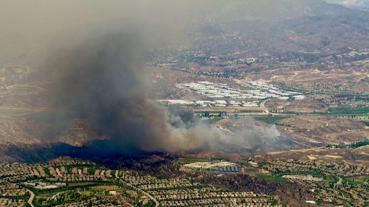 A brush fire erupted near Magic Mountain in Valencia on Tuesday, May 28, 2013.