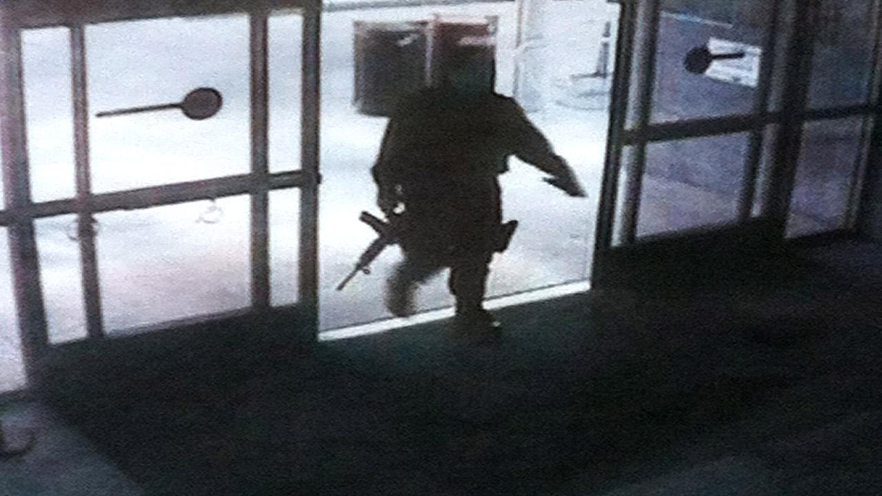 A surveillance photo shows the suspected gunman entering the Santa Monica College library on Friday, June 7, 2013.