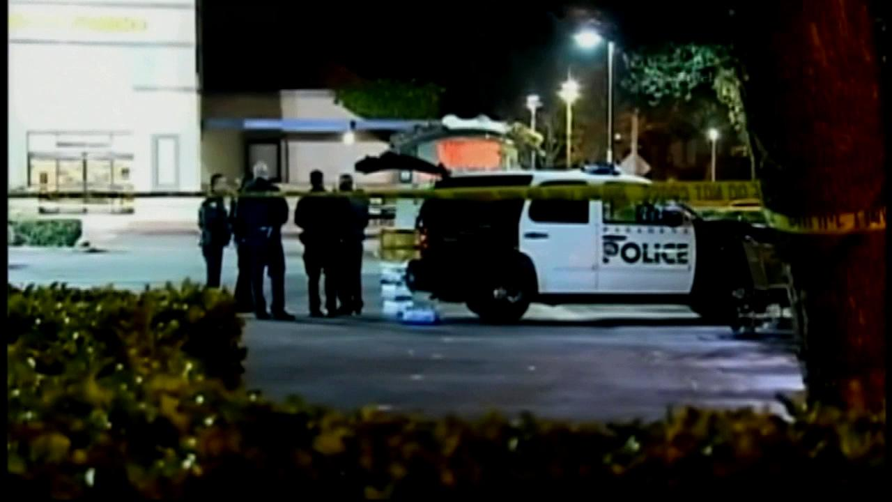 Pasadena police officers stand near the scene of a fatal officer-involved shooting involving a robbery suspect on Saturday, March 24, 2012.