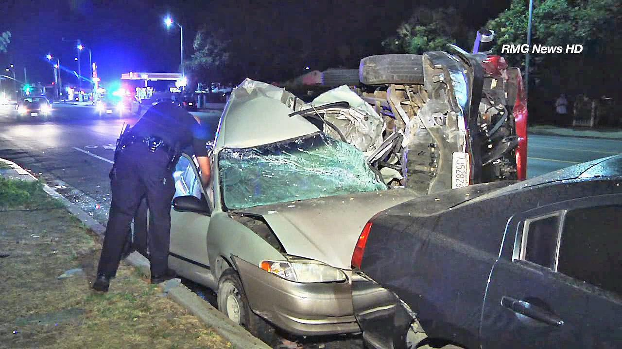 Vehicles are seen following a multi-car crash in Reseda Sunday, June 30, 2013.